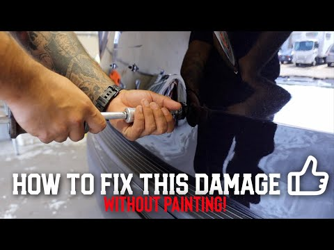 Learn how to fix this Large Dent on a Ford Explorer | Paintless Dent Removal