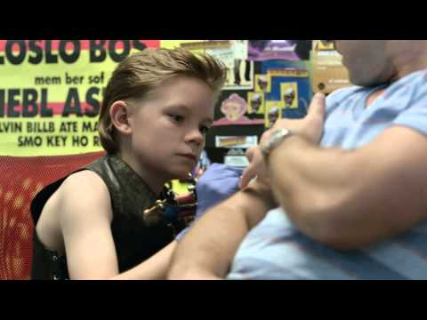 Little kid gives guy tattoo