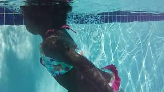 2 year old baby girl falls in pool head first