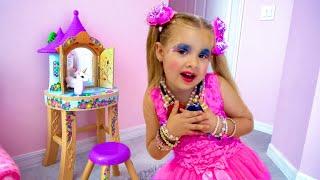 Diana brinca de trocar de roupa e com maquiagens de brinquedo