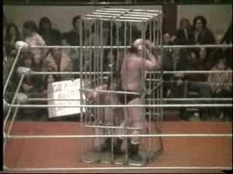 WRESTLING MATCH IN A SHARK CAGE