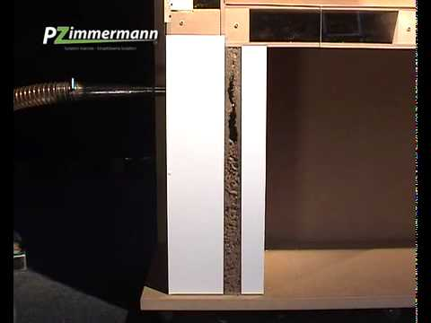 isolation par insufflation de laine de roche dans le vide des doubles murs youtube. Black Bedroom Furniture Sets. Home Design Ideas