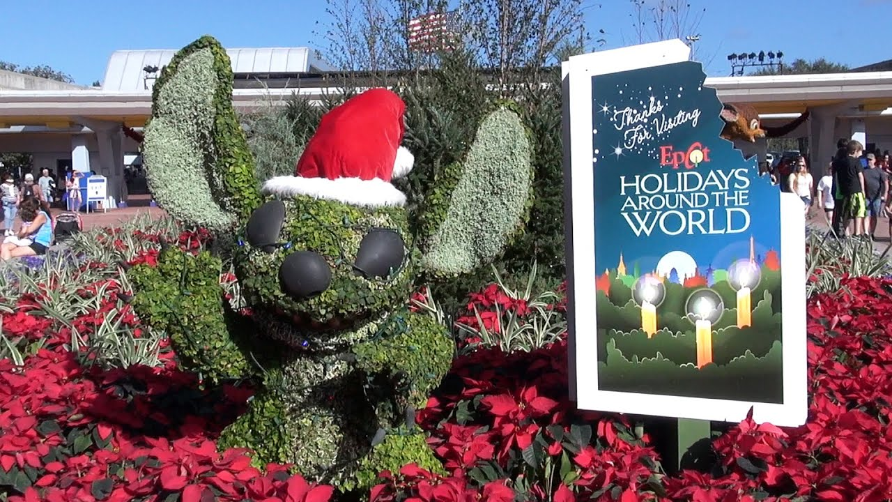 epcot holidays around the world 2015 decorations overview including topiaries christmas tree - Christmas Around The World Decorations
