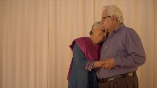 Retired Indian old couple hugs each other at home
