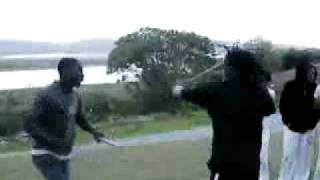 Capoeira dancing and Xhosa stick fighting