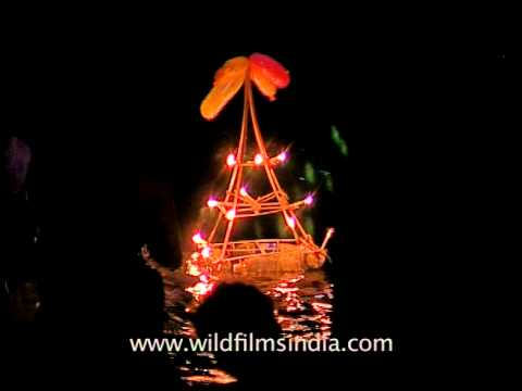 Pilgrims offering big lighted lamps to Pampa river in Sabarimala