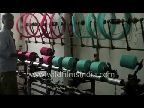Yarn spindles at Textile manufacturing unit in India