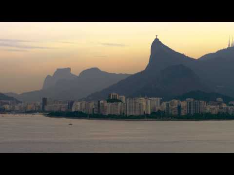 Aerial shot of Rio, ocean, and religious landmark.