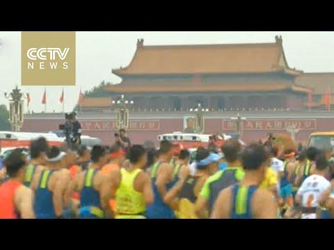 Beijing Marathon: Runners raising money for charity