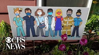 Mom turns doodles of frontline workers into popular yard signs