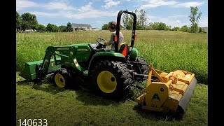 John Deere 3038e mowing with an Alamo SHD88 flail mower