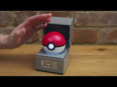 An electronic die-cast replica of The Wand Company Poké Ball