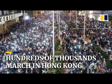 Hundreds of thousands joined Hong Kong's first march approved by police since August