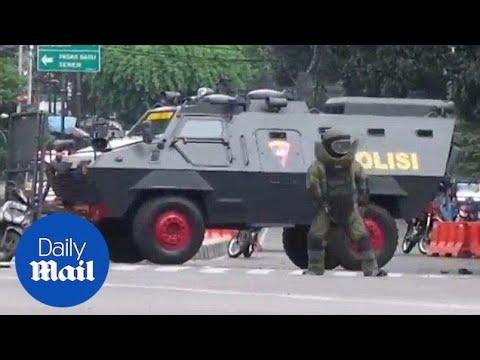 Bomb squad officer investigates scene of Jakarta bombing - Daily Mail