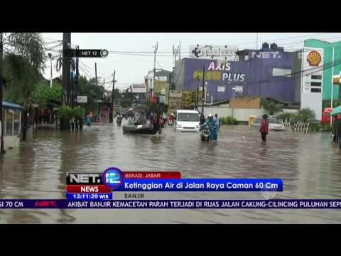 Sejumlah Motor Mogok Nekat Menerobos Banjir di Jalan...