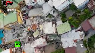 Grim aftermath: Drone buzzes over collapsed building after quake strikes Italian island