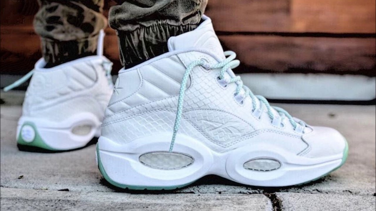 The Reebok Question Returns in  Mint Glow  Snakeskin detailing on this new  colorway 415e69a1b