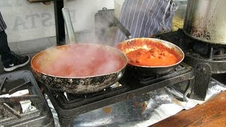 London Street Food. Cooking A Perfect Italian Pasta With Red Pesto