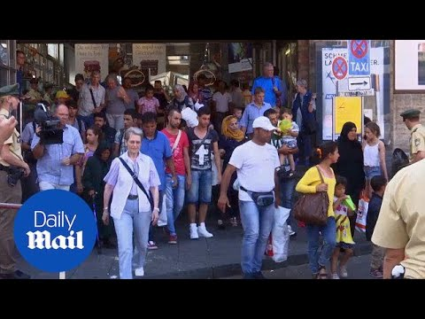 Hundreds of migrants arrive in Munich from Budapest by train - Daily Mail