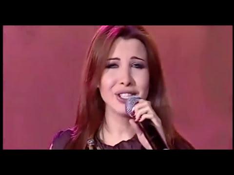Nancy Ajram - Lessa Gayya Aqoul (Official Video) نانسي ...