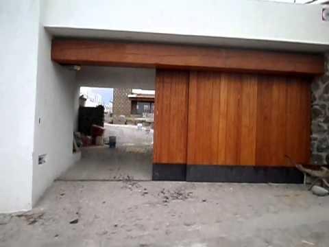 Puerta corrediza de madera automatizada con spazicd1000 for Puertas corredizas
