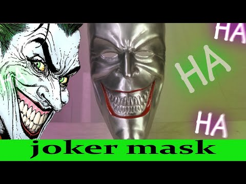 Hand Making A Joker Mask Out Of Metal(killing joke)