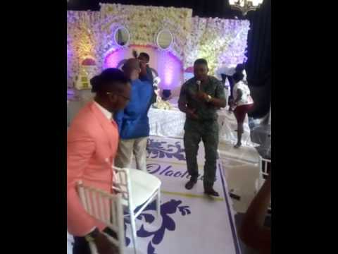 Konstant performing his song morenikeji in a wedding