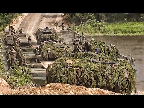 NATO Armored Vehicles Cross River On Pontoon Bridge