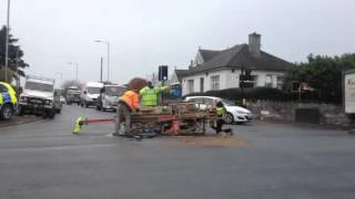 Digger topples over at junction of Pomphlett Road in Plymstock, Pymouth, Devon