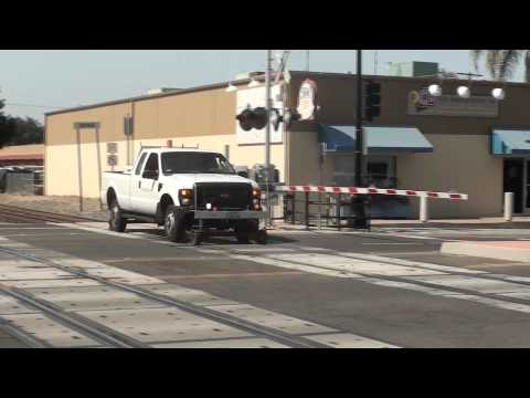 Metrolink Truck crosses the Orange, CA Train Station
