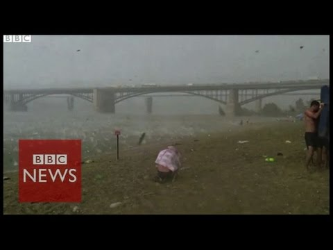 Freak hailstorm surprises Russian beach goers - BBC News