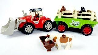 Tratores de brinquedo. Um trator na fazenda. Animais para crianças.