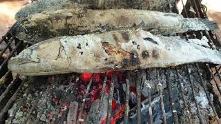 Cooking traditional food and grilled fish in my homeland