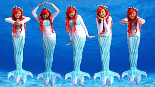 Five little mermaids jumping on the bed!