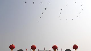 Military parade begins with helicopter formation