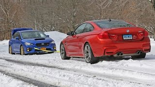 wrx sti vs bmw m4 snow tow summer tires awd vs winter tires rwd