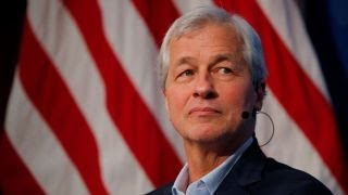 JPMorgan's Jamie Dimon says he could beat Trump in an election