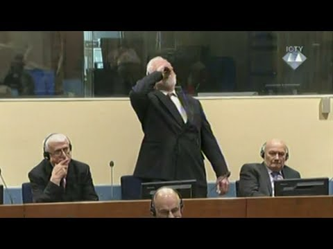 Bosnia war criminal dies after taking poison in court