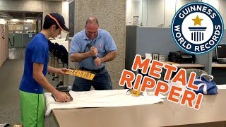 Olympic Strongman tears license plates in half! - Guinness World Records