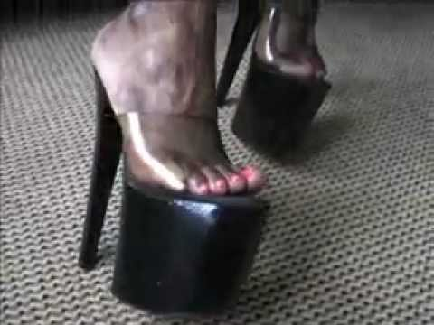 Golden mules footplay under the chair