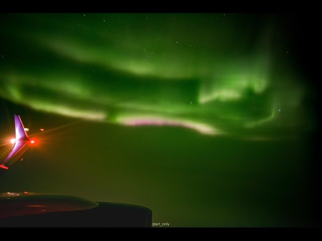 Passenger Spots Northern Lights from Plane Window, Takes Amazing