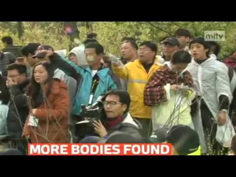 mitv - Families of passengers on a sunken South Korean ferry protest over rescue operation