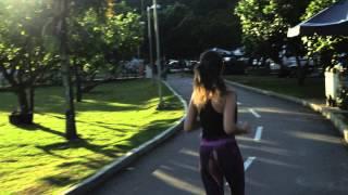 Young woman jogging along Lagoa Rodrigo de Freitas