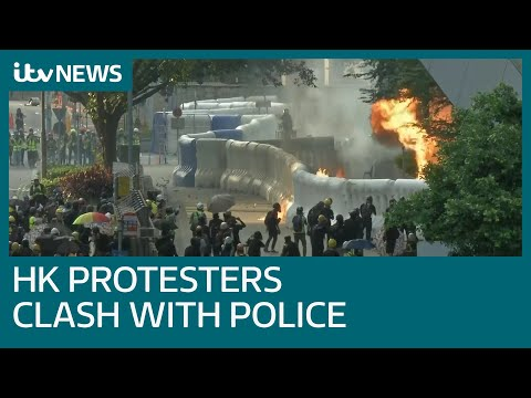 Hong Kong protesters throw petrol bombs as police respond with tear gas | ITV News