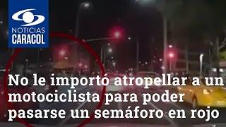 No le importó atropellar a un motociclista para poder pasarse un semáforo en rojo