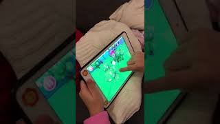 Natty playing Shopkings game with her IPad