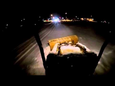 Night time snow plowing