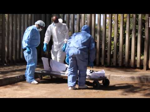 Dismembered body being removed from crime  in Killarney.