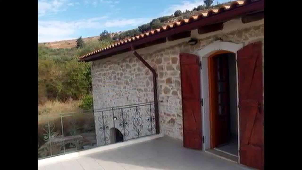 Traditional Greek Houses seaside real estate in greece - traditional stone house for sale