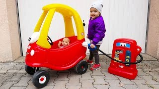 Little Girl Elis and Baby Doll Ride On Power Wheel and Little Tikes Cozy Coupe ran out of Petrol